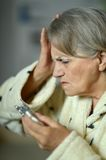 Senior  woman with pills Royalty Free Stock Photography