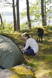 Senior woman pitches a tent Stock Photos