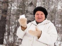 Senior Woman play snowballs Stock Photos