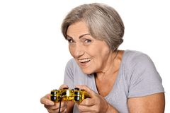 Senior woman play video game Royalty Free Stock Photography