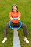 Senior woman at playground Stock Photography