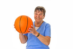 Senior woman playing basketball Royalty Free Stock Photo