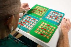 Senior woman playing bingo Royalty Free Stock Photos