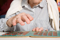 Senior woman playing bingo Stock Image