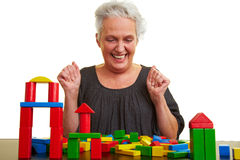Senior woman playing with building Royalty Free Stock Photos