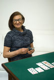 Senior woman playing cards. Senior woman playing a game of cards Royalty Free Stock Photo