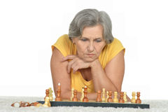 Senior woman playing chess Royalty Free Stock Photography