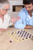 Senior woman playing chess Stock Photos