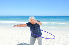 Senior woman playing with her hoop Royalty Free Stock Photo