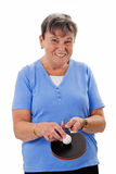 Senior woman playing pingpong Royalty Free Stock Photography