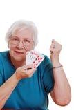 Senior woman playing poker Stock Photography