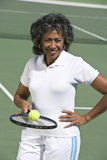 Senior Woman Playing Tennis In Court Stock Photo