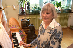 Senior woman plays piano Royalty Free Stock Photo