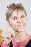 Senior woman pointing  Stock Photos