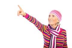 Senior woman pointing away royalty free stock photos
