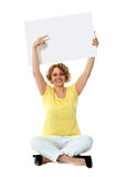 Senior woman pointing at blank ad board Stock Photography