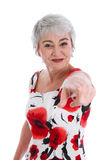 Senior woman pointing with finger - isolated in red and white Stock Images