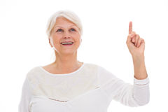 Senior woman pointing Royalty Free Stock Images