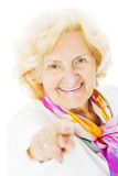 Senior Woman Pointing Over White Background Royalty Free Stock Image