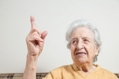Senior woman pointing something Stock Image
