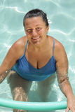 Senior woman in the pool Royalty Free Stock Images