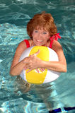 Senior woman in the pool royalty free stock photography
