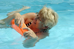 Senior woman in pool stock photo