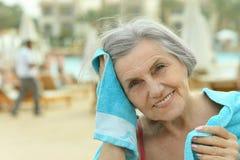 Senior woman at pool with towel Royalty Free Stock Image