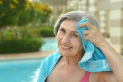 Senior woman at pool with towel Royalty Free Stock Photo