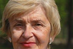 Senior woman portrait. Outdoor portrait of a happy senior woman Stock Image