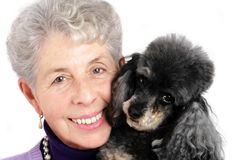 Senior woman portrait with her poodle Stock Image