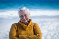 Senior woman posing with crossed arms Royalty Free Stock Photography