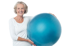 Senior woman posing with exercise ball Royalty Free Stock Image