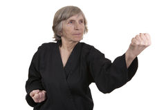 Senior woman practicing martial arts Stock Image