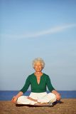 Senior woman practicing morning yoga Royalty Free Stock Photography