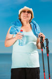 Senior woman practicing nordic walking on beach Stock Photography
