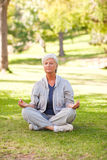 Senior woman practicing yoga Royalty Free Stock Images