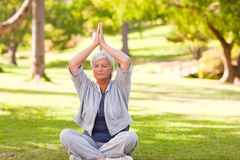 Senior woman practicing yoga Stock Photos