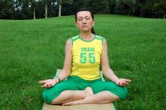 Senior woman practicing yoga Royalty Free Stock Photos
