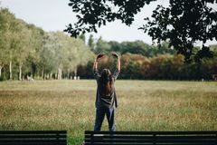 Senior woman practicing yoga at the park in italy stock photo