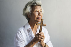 Senior woman prayer faith in christianity religion Stock Image