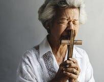 Senior woman prayer faith in christianity religion Royalty Free Stock Image