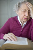 Senior woman praying. Elderly woman reading and meditating Stock Image