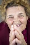 Senior woman praying Royalty Free Stock Photo