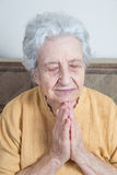 Senior woman praying / doing meditation Royalty Free Stock Photography