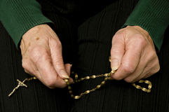 Senior woman praying with her rosary Royalty Free Stock Images