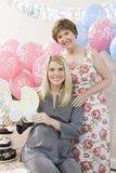 Senior Woman And Pregnant Daughter At A Baby Shower Royalty Free Stock Photo
