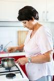 Senior woman preparing food royalty free stock photo