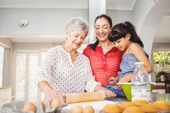 Senior woman preparing food with family Stock Photography