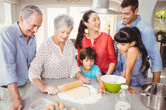 Senior woman preparing food with family Stock Images